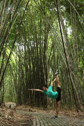 yoga pose inside bamboo forest