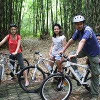 Family bike tour inside the forest
