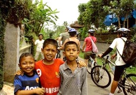 Cheers of Balinese children during cycling tours