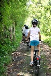 Cycling with children through bali's green countryside